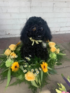 3D Black Dog on a Bed of Flowers