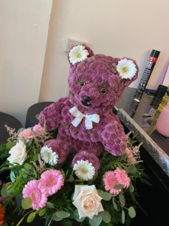 3D Sitting Bear on Bed of Flowers